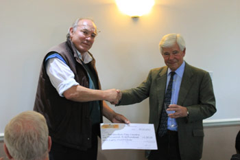Peter Costain receiving a cheque for Tenterden Day Centre